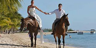 Horse Riding On The Beach